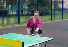 Girl plays table tennis Stock Image