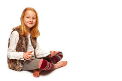 Girl plays Tablet. Young Girl with tablet portrait stock images