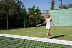 Girl plays tennis. Lucky girl and a friend played tennis on the court Stock Photos