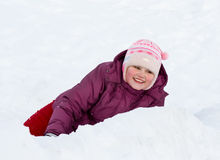 Girl plays to snow Stock Photography