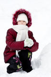 Girl plays to snow Stock Image