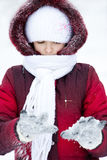 Girl plays to snow Stock Photos