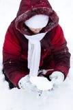 Girl plays to snow Stock Photos