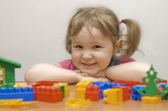 Girl plays with toy blocks Royalty Free Stock Images