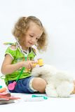 The girl plays with toy tools Royalty Free Stock Images