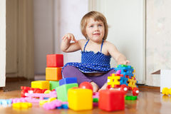 Girl plays with toys in home interior Stock Photography