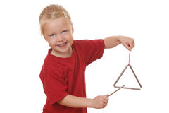 Girl plays triangle Stock Photo
