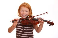 Girl plays violin Stock Images