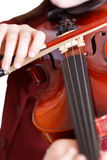 Girl plays on violin by bow isolated Stock Image