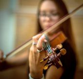 Girl plays the violin Stock Photo