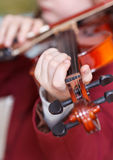 Girl plays on violin - chord on fingerboard Royalty Free Stock Image