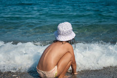 Girl plays with waves Stock Photos