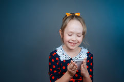 The girl plays with white phone Stock Images