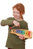 Girl plays xylophone Royalty Free Stock Photo