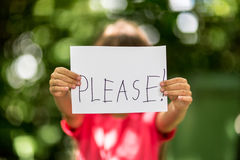 Girl with Please sign Stock Images