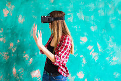 Girl with pleasure uses head-mounted display Royalty Free Stock Images
