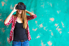 Girl with pleasure uses head-mounted display Stock Photo