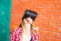 Girl with pleasure uses head-mounted display Royalty Free Stock Photo