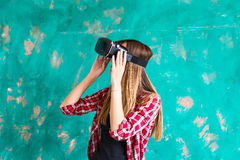 Girl with pleasure uses head-mounted display Stock Photos