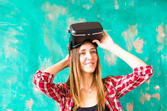 Girl with pleasure uses head-mounted display Stock Images