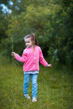 Girl plucked grass Stock Image