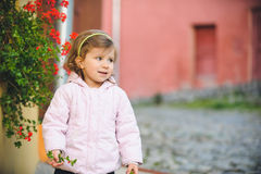 Girl Plucking Flowers Royalty Free Stock Photos