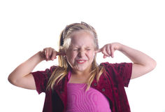 Girl Plugging Ears Stock Photo