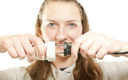 Girl plugging (unplugging) wires Royalty Free Stock Photos