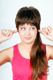 Girl plugs fingers in his ears Royalty Free Stock Photos
