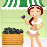Girl with plums Royalty Free Stock Images