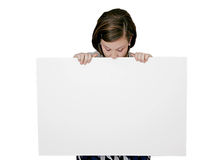 Girl plus sign equals kilroy. Young girl with a sign immitating Kilroy was here Royalty Free Stock Photos
