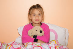 Girl And Plush Dog Royalty Free Stock Photos