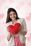 Girl with plush red heart Stock Images