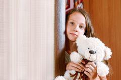 Girl with plush toy Royalty Free Stock Photo