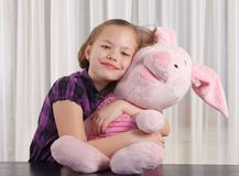 Girl with plush toy Stock Image