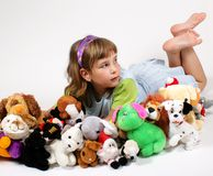 Girl and plushy toys Royalty Free Stock Image