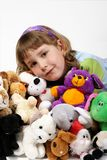 Girl and plushy toys Stock Image