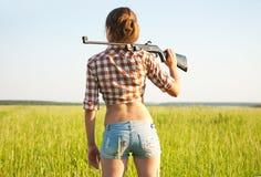 Girl with  pneumatic air  rifle Stock Photos