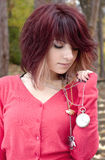Girl with pocket watch Stock Images