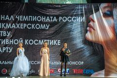 The girl on the podium. Girl party open semifinal of the Championship of Russia of the city of Orenburg on hairdressing, nail modelling, design and decorative Stock Image