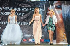The girl on the podium. Girl party open semifinal of the Championship of Russia of the city of Orenburg on hairdressing, nail modelling, design and decorative Stock Photography