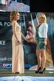 The girl on the podium. Girl party open semifinal of the Championship of Russia of the city of Orenburg on hairdressing, nail modelling, design and decorative Royalty Free Stock Photo