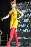 The girl on the podium -. Girl party open semifinal of the Championship of Russia of the city of Orenburg on hairdressing, nail modelling, design and decorative Stock Images