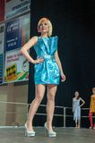 The girl on the podium -. Girl party open semifinal of the Championship of Russia of the city of Orenburg on hairdressing, nail modelling, design and decorative Royalty Free Stock Images