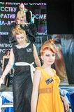 The girl on the podium -. Girl party open semifinal of the Championship of Russia of the city of Orenburg on hairdressing, nail modelling, design and decorative Stock Photo