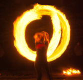 Girl with poi performs fire circle Royalty Free Stock Image