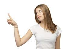 Girl point. Pretty girl push on white background Royalty Free Stock Photos