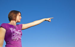 Girl pointing Stock Photography
