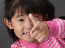 Girl pointing Stock Photo