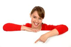 Girl pointing. Woman pointing at a blank board Stock Photos